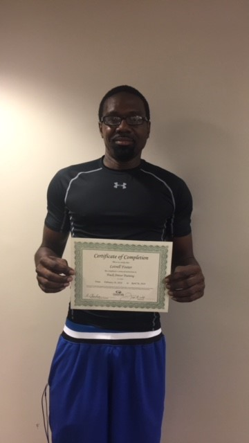 Lestrell Foster, a WIOA Program graduate holding his certificate of completion